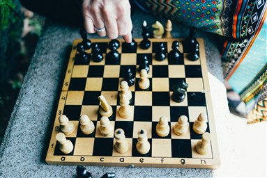 photo of friends playing chess
